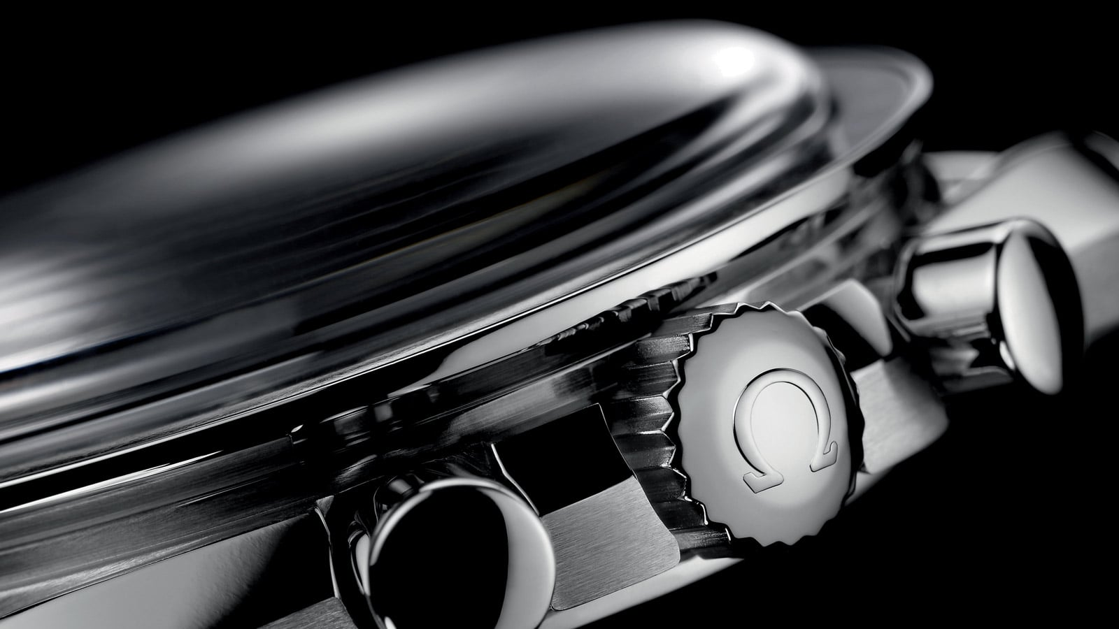 Side view of the Omega SPEEDMASTER PROFESSIONAL MOONWATCH steel crown and pushers