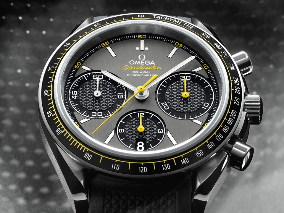 Close-up view of the Omega THE SPEEDMASTER RACING 40 millimeters with steel case a grey dial and a yellow second hand