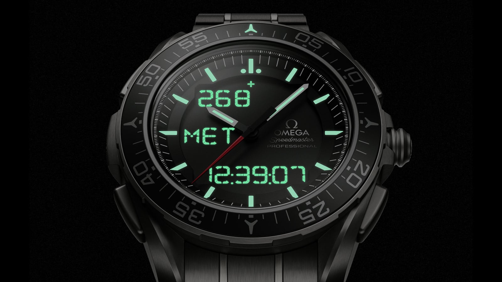 Close-up view of the Omega SPEEDMASTER SKYWALKER X-33 case in the night with the LCD opening in the dial back-illuminated