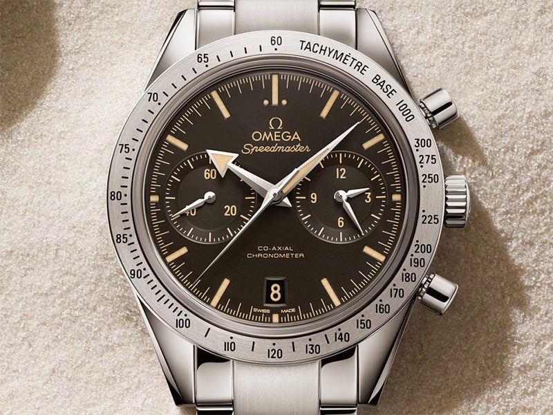 Closeup of the Speedmaster '57 with a steel case and black dial