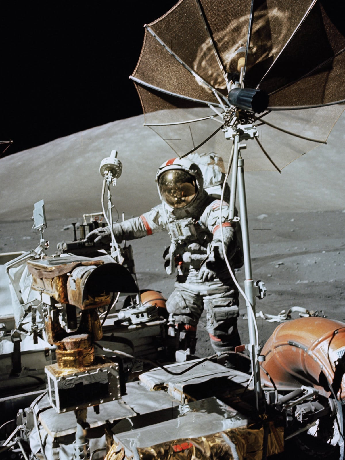 Gene Cernan walking on the Moon next to a lunar vehicle
