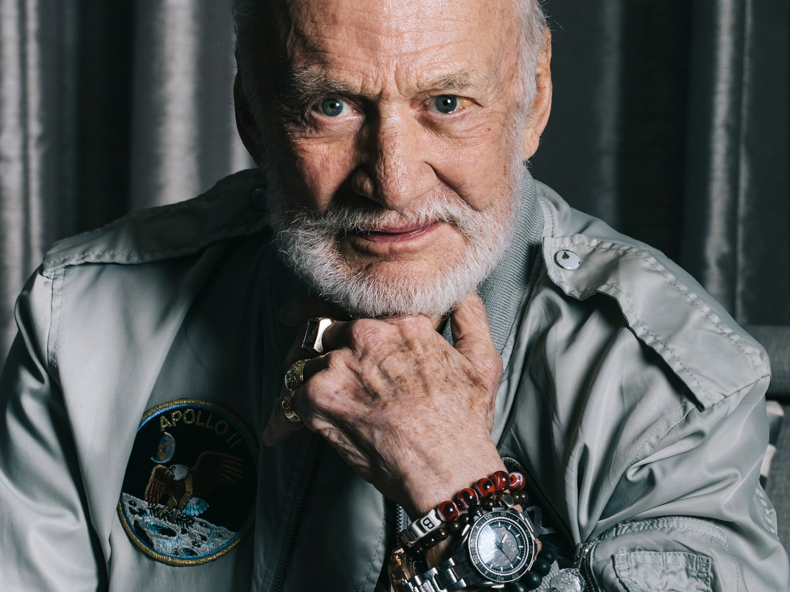 Buzz Aldrin in his astronauts suit faces the camera