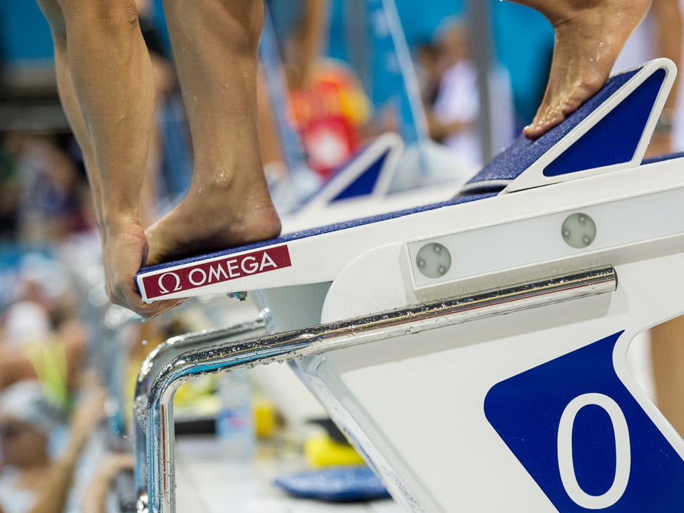 Close view of a swimming pool starting block with an Omega logo