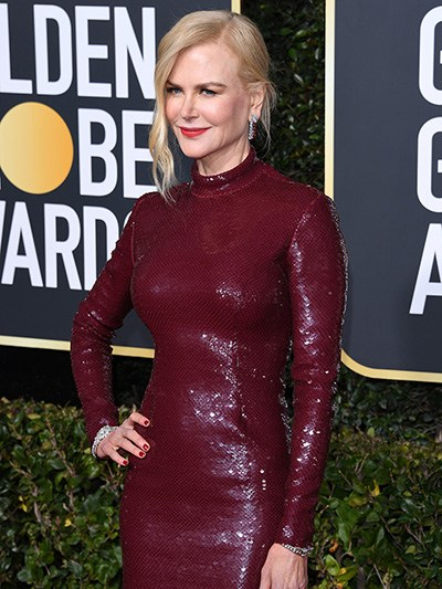 Nicole Kidman wearing a red dress with a dazzling OMEGA watch on her wrist at the 76th Golden Globes