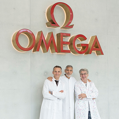 George Clooney, Raynald Aeschlimann and Nick Hayek at the Omega factory
